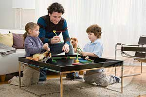 Father and kids playing game